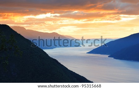 Aerial view of Norwegian fjords at sunset - stock photo