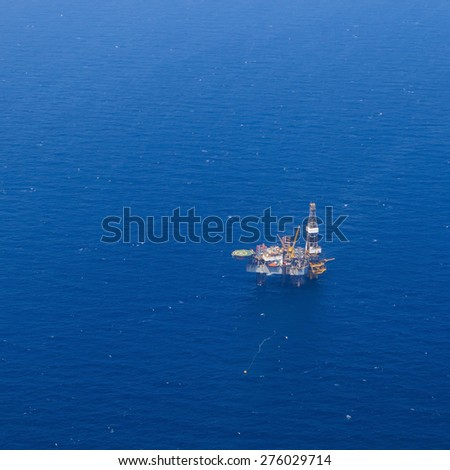 Aerial View of Offshore Jack Up Drilling Rig in The Middle of The Ocean - stock photo