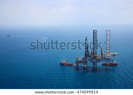 Aerial View of Offshore Jack Up Drilling Rig in The Middle of The Ocean:Selective focus with shallow depth field.