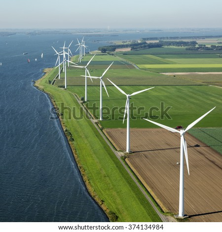 Aerial view of offshore wind turbine farm in along the Volkerak, The Netherlands.  - stock photo
