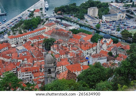 Aerial view of old medieval town Kotor, Montenegro. Serbian orthodox church of St Nicholas  - stock photo