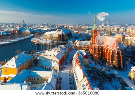 Aerial view of Old Town and Ostrow Tumski with church of the Holy Cross and St. Bartholomew from Cathedral of St. John in the winter morning in Wroclaw, Poland - stock photo