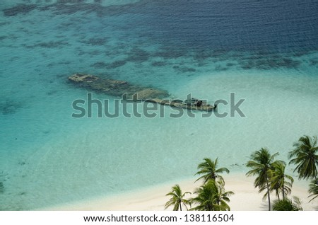 Aerial view of old wreck and palm tree in a tropical beach, San Blas archipelago, Panama, Central America - stock photo