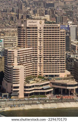Aerial view of one of the prominent buildings in downtown Cairo as viewed from the top of Cairo Tower. Cairo, Egypt - April 26, 2014. - stock photo