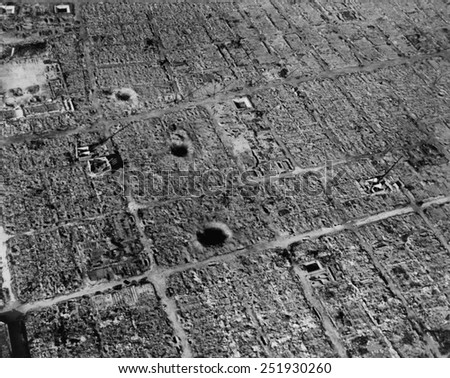 Aerial view of Osaka, Japan, after firebombing by U.S. incendiary bombs. The city suffered three bombing campaigns by B-29 Superfortresses from March to August 1945. - stock photo