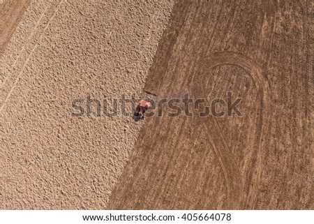 aerial view of  over the tractor on  harvest field in Poland - stock photo