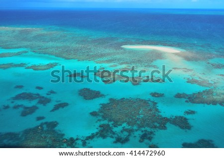 Aerial view of Oyster coral reef at the Great Barrier Reef near Cairns in Tropical North Queensland, Queensland, Australia. - stock photo