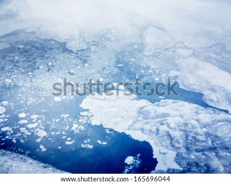 aerial view of pack ice near greenland - stock photo