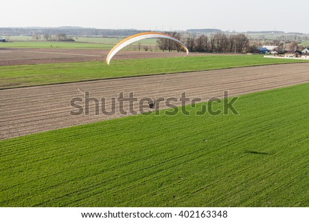 aerial view of paramotor flying over the fields in Poland
