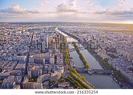 Aerial view of Paris and Seine river from Eiffel tower at sunset. - stock photo