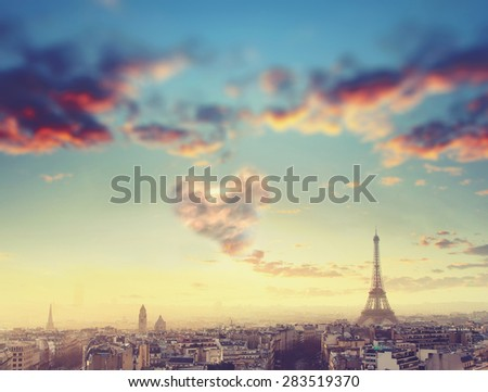 Aerial View of Paris skyline and Eiffel tower with cloud in form of heart, France. Business, Love and travel concept - stock photo