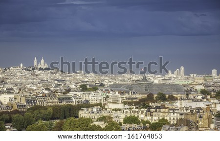 Aerial view of Paris with Sacre Coeur Basilica and Grand Palace with french flag, France