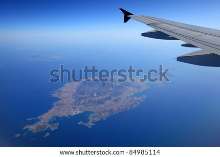 Aerial view of Paros Island in navy blue Aegean Sea. - stock photo