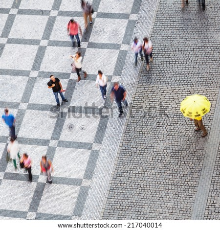 aerial view of people in motion blur walking on a city square - stock photo