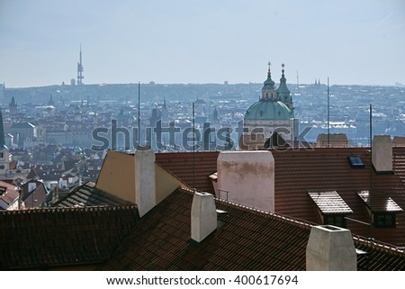 Aerial view of Prague with red roofs and remote TV tower  - stock photo
