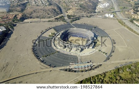 Aerial view of Qualcomm Stadium, San Diego in Southern California, United States of America and trolley line. A stadium used for concerts, the super bowl, football, baseball games and other sports. - stock photo
