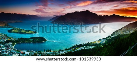 Aerial view of Queenstown with lake Wakatipu at Dusk in panorama