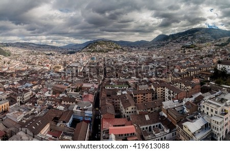 Aerial view of Quito, capital of Ecuador. El Panecillo hill in the middle. - stock photo