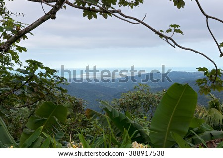 aerial view of rainforest and caribbean ocean from atop luquillo mountains in el yunque puerto rico - stock photo