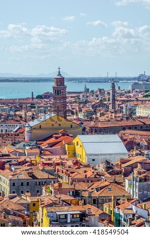 aerial view of red rooftops of the historical center of italian city venice - stock photo
