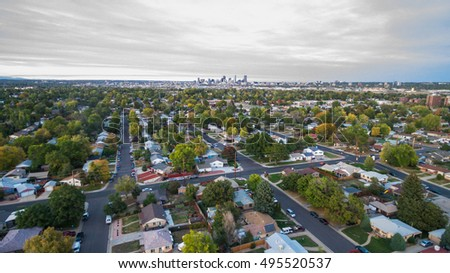 Aerial view of residential neighborhood with view of downtown Denver.