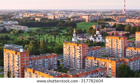 Aerial view of residential (sleeping) district and orthodox church in the sunset time. Klaipeda city, Lithuania. - stock photo