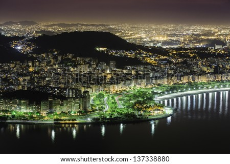 Aerial view of Rio De Janeiro by night in Brazil - stock photo