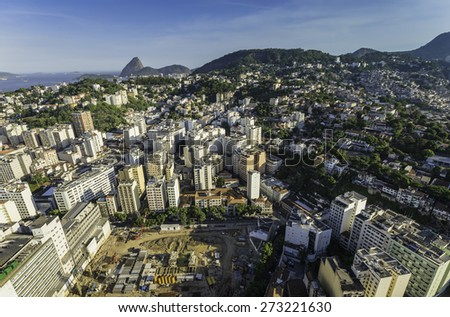 Aerial view of Rio de Janeiro construction site with buildings on the hills, Brazil - stock photo