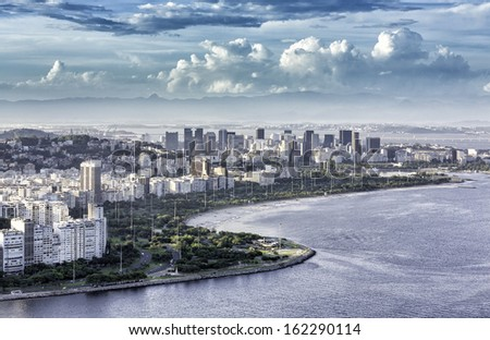 Aerial view of Rio de Janeiro Downtown with dramatic clouds in Brazil - stock photo