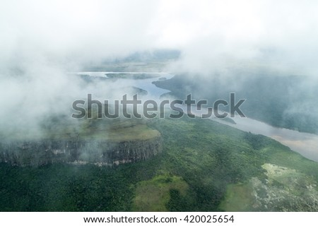 Aerial view of river Caroni and one of the tepuis (table mountains) in Venezuela - stock photo