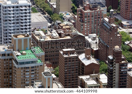 Aerial view of rooftops over a New York City housing project for low income people. High crime area for violence where police enforce at night. Daytime photo