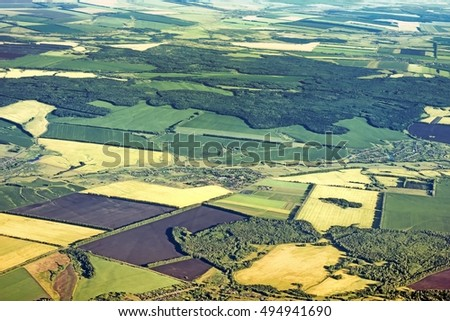 aerial view of rural countryside landscape scenery in central europe ural russia with agricultural field crop forest village settlement road detail satellite exterior top down above overview