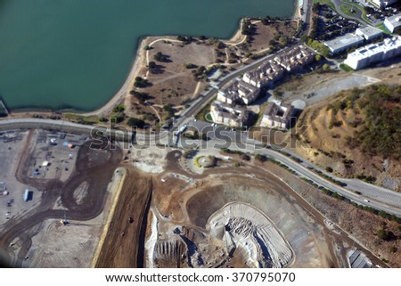 Aerial View of San Francisco Candlestick Park dirt hole and shoreline as iconic stadium former home of Giants and 49ers is deconstructed to make way for new project in California. - stock photo