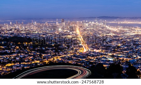Aerial view of San Francisco cityscape and city lights at night - stock photo