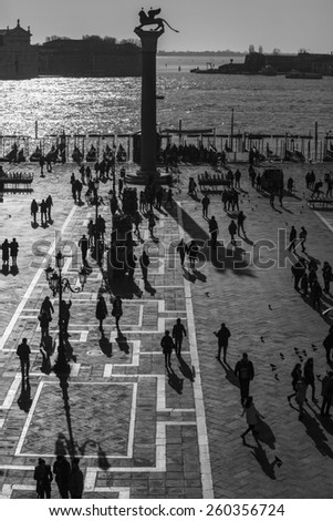 Aerial view of San Marco Piazza (Saint Marc Square): Shadow of tourist on the square - stock photo