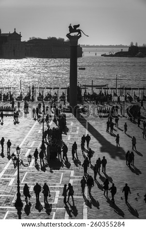 Aerial view of San Marco Piazza (Saint Marc Square): Shadow of tourists on the square - stock photo