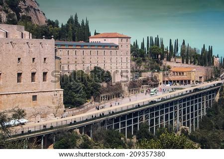 Aerial view of Santa Maria de Montserrat Monastery in Catalonia, Spain with Mountain - stock photo
