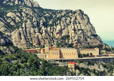Aerial view of Santa Maria de Montserrat Monastery in Catalonia, Spain with Mountain. Toned photo - stock photo