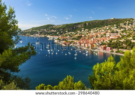 Aerial view of scenic French Riviera mediterranean coast with medieval coastal town Villefranche-sur-Mer, Cap de Nice and leisure boats anchored in harbor - stock photo