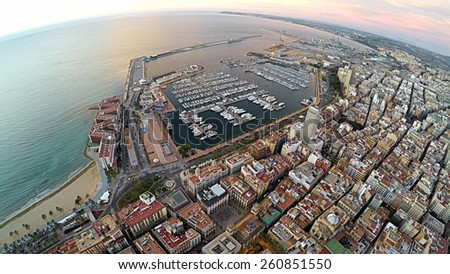 Aerial View of seaside part of Alicante and port. Spain / STUNNING VIDEO AVAILABLE (UHD Quality) on my footage gallery. - stock photo