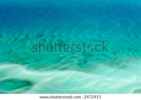 Aerial view of shallow coastal waters of the tropical coast of Mozambique - stock photo