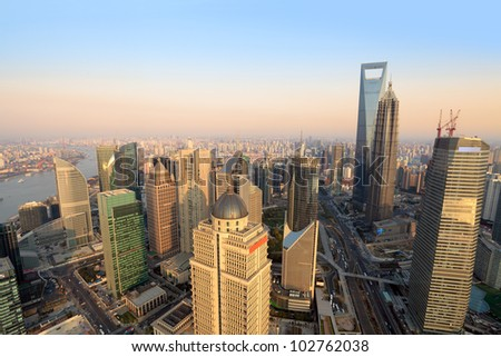 aerial view of shanghai lujiazui finance and trade zone at dusk from the oriental pearl tv tower - stock photo