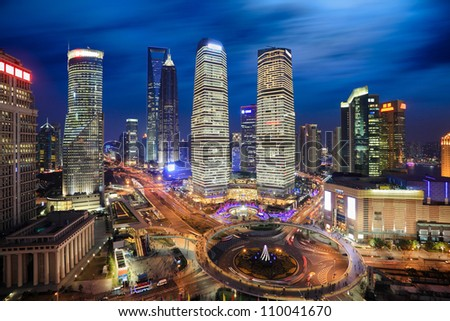 aerial view of shanghai lujiazui finance and trade zone at night - stock photo