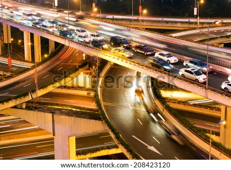 Aerial view of Shanghai viaduct night, severe traffic congestion. - stock photo