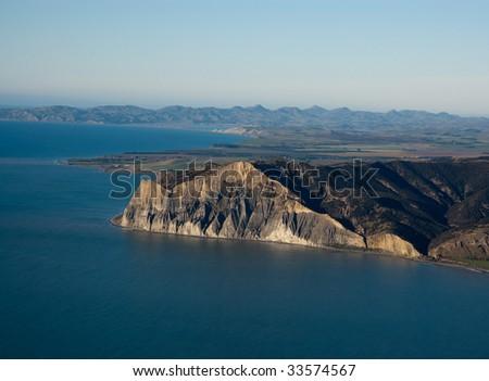 Aerial view of sheer cliffs near Blenheim, NZ - stock photo