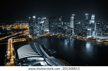 Aerial view of Singapore at night with traffic