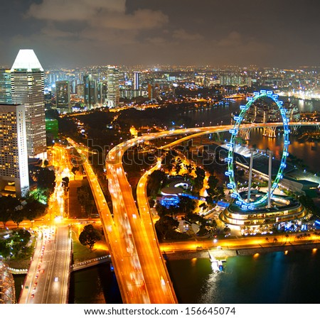 Aerial view of Singapore with Singapore Ferries Wheel - stock photo