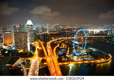 Aerial view of Singapore with Singapore Flyer in the right corner - stock photo