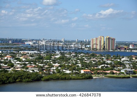 Aerial view of Singer Island, with the Port of Palm Beach, the Blue Heron Bridge, and marinas, near West Palm Beach, Florida. - stock photo