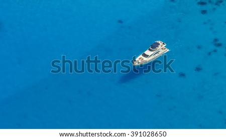 Aerial view of single yacht in azure sea - stock photo